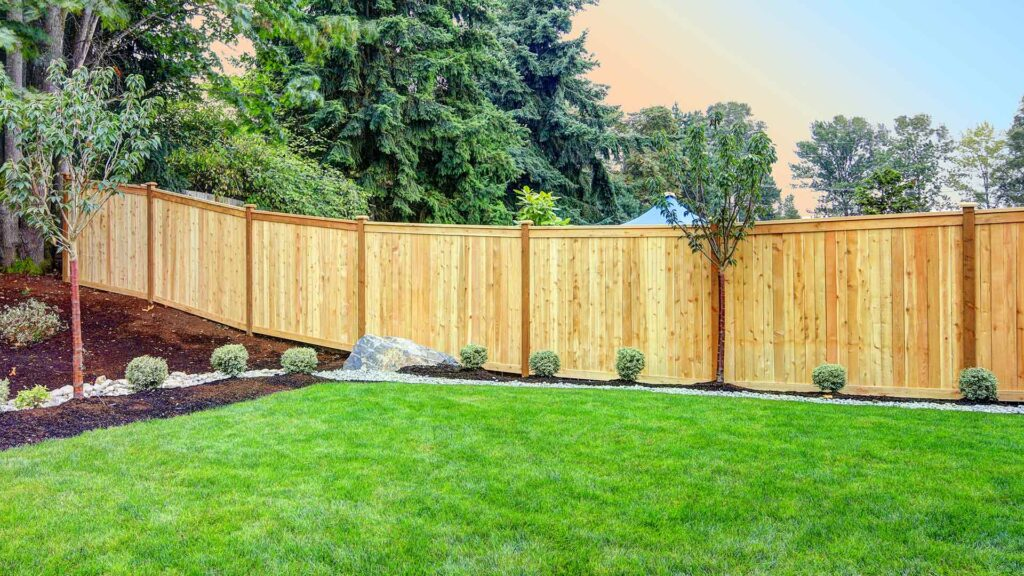 large wood fence with lawn